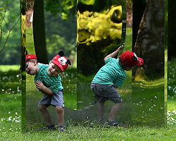 © Licensed to London News Pictures. 24/05/2012. Waddesdon, UK. Felix Stevens aged three visiting from Thame plays on a Mirror Sculpture by Jeppe Hein in the grounds of the Manor. People enjoy the warm weather amongst an exhibition of contemporary sculpture at Waddesdon Manor, Buckinghamshire, today 24th May 2012. The exhibition is being held by Christie's as part of a private sale. Photo credit : Stephen Simpson/LNP