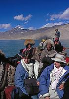 Crossing Brahmaputra with pilgrims.