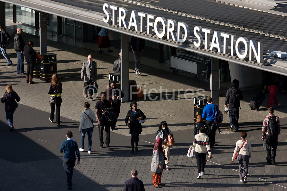 Aerial view of commuters Stratford station in east London, the rail transport hub for the 2012 Olympics. The low-level station was substantially rebuilt in the late 1990s as part of the Jubilee Line Extension works, with a large new steel and glass building designed by Wilkinson Eyre that encloses much of the low-level station, and a new ticket hall. Stratford station is a large multilevel railway station in Stratford, east London. The station is served by the National Rail services National Express East Anglia, London Overground and c2c, by London Underground's Central and Jubilee lines, and by the Docklands Light Railway (DLR). Stratford is in London Travelcard Zone 3, and Network Rail owns the station.