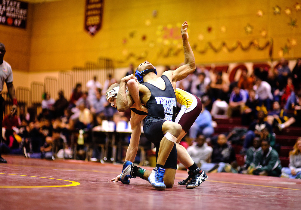 (staff photo by Matt Roth)..Hereford's Jonny Volz beat Western Tech's Wavie Gibson in the 135 championship match during the Baltimore County Wrestling Championships at New Town High School Saturday, February 20, 2010.