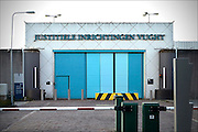 Nederland, Vught, 13-1-2015 Penitiare Instelling Vught. Hoge hekken en muren met prikkeldraad schermen de lokatie af. cameratoezicht. Extra Beveiligde Inrichting of afgekort EBI is een speciale afdeling van de Nederlandse penitentiaire inrichting PI Nieuw Vosseveld in Vught. Hier worden ook terreurverdachten en veroordeelden opgesloten. Foto: Flip Franssen/ Hollandse Hoogte