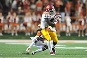AUSTIN, TX - OCTOBER 18:  E.J. Bibbs #11 of the Iowa State Cyclones is wrapped up after a catch against the Texas Longhorns on October 18, 2014 at Darrell K Royal-Texas Memorial Stadium in Austin, Texas.  (Photo by Cooper Neill/Getty Images) *** Local Caption *** E.J. Bibbs