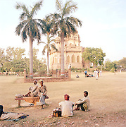 Locals relax in the grounds of the Begum Hazrat Mahal Park, Lucknow, Uttar Pradesh, India