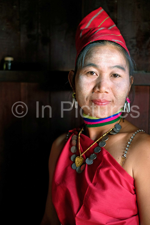 Portrait of a Kayah Red Karen ethnic minority woman on 18th January 2016 in Kayah State, Myanmar. Myanmar is one of the most ethnically diverse countries in Southeast Asia with 135 different indigenous ethnic groups with over a dozen ethnic Karenni subgroups in the Kayah region. Kayah women wear a simple red tunic worn with a broad white sash decorated with coloured tassles and a striped hand-woven head-cloth  tunic worn with a broad white sash decorated with coloured tassles and a striped hand-woven head-cloth photo by Tessa Bunney/In Pictures via Getty Images tunic worn with a broad white sash decorated with coloured tassles and a striped hand-woven head-cloth photo by Tessa Bunney/In Pictures via Getty Images