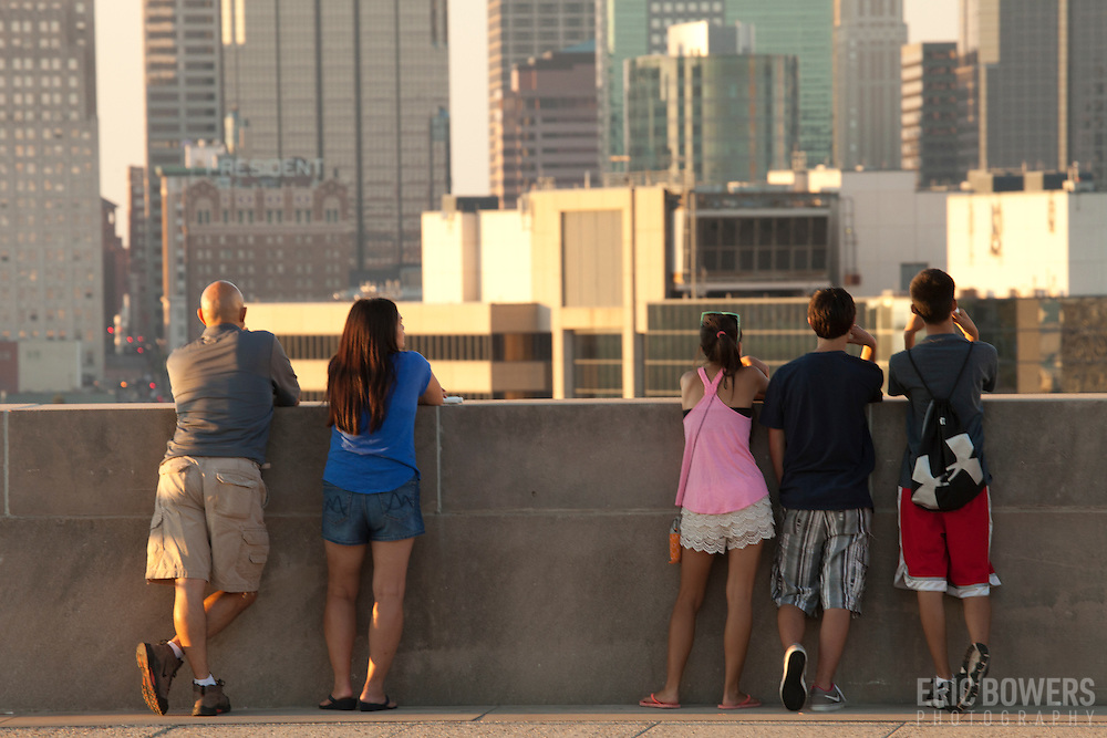 People taking in the view of the Kansas City MO skyline from the overlook area at the Liberty Memorial National World War One Museum.