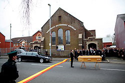 © Licensed to London News Pictures. 22/03/2016. Belfast, Northern Ireland, UK. Friends and family prepare to carry the coffin of murdered prison officer Adrian Ismay to Woodvale Methodist church. Mr Ismay died following a booby-trap bomb that exploded under his van in East Belfast on March 4th. Photo credit: Peter Morrison/LNP
