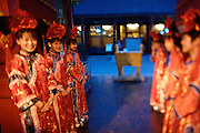 """Qiongdao (Jade Island) in Beihai Lake. Fangshan Imperial Food Restaurant. Waitresses dressed """"imperial style"""" welcoming guests with a classic dance at the courtyard."""