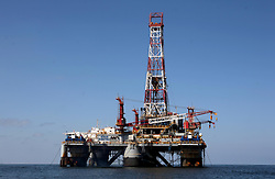 05 May 2010. Venice, Louisiana. Deepwater Horizon, British Petroleum environmental oil spill disaster.<br /> Despite the recent tragedy dooming the Deepwater Horizon oil platform, drilling for more oil continues at a pace just 10 mjiles south of Venice Marina, 34 miles closer to land than Deepwater. The 'Ocean Saratoga' drilling platform digs in to the Gulf.<br />  Photo credit;Charlie Varley/varleypix.com