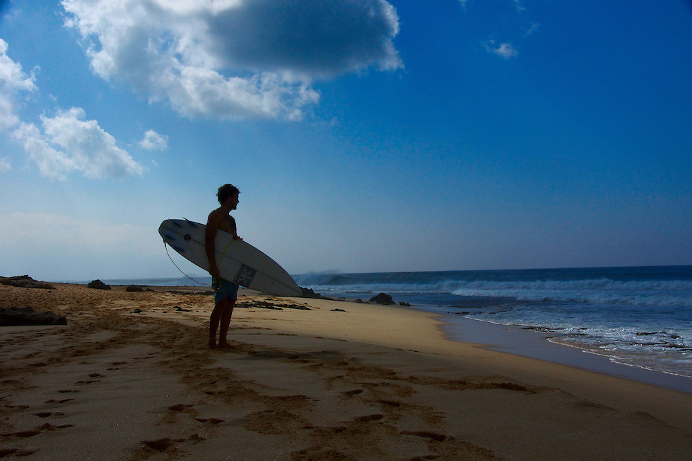 Surfing is a surface water sport were a person rides a wave by standing on a surf board.  Surfing is typically done in oceans were waves are a regular occurrence.