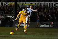 Newport's Max Porter is tackled by Wimbledon's Luke Moore (r). . Skybet football league 2, Newport county v AFC Wimbledon match at Rodney Parade in Newport, South Wales on Tuesday 25th Feb 2014.<br /> pic by Andrew Orchard, Andrew Orchard sports photography.