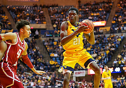 Feb 2, 2019; Morgantown, WV, USA; West Virginia Mountaineers forward Wesley Harris (21) grabs a rebound during the second half against the Oklahoma Sooners at WVU Coliseum. Mandatory Credit: Ben Queen-USA TODAY Sports