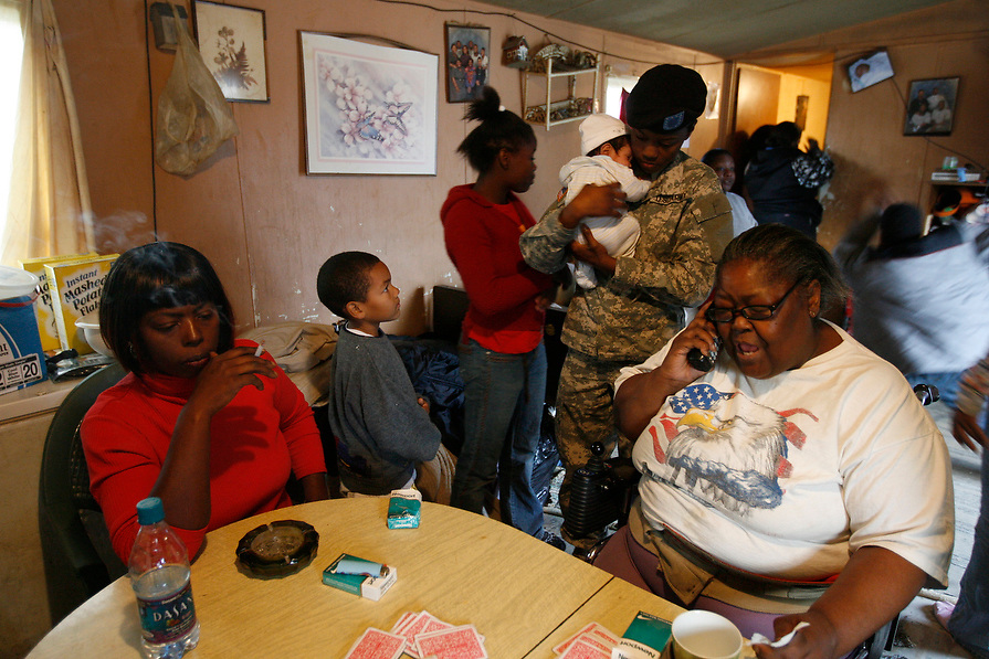 After coming home from Army basic training, Tia comforts her niece as she spends time with her family at her grandmother's house.