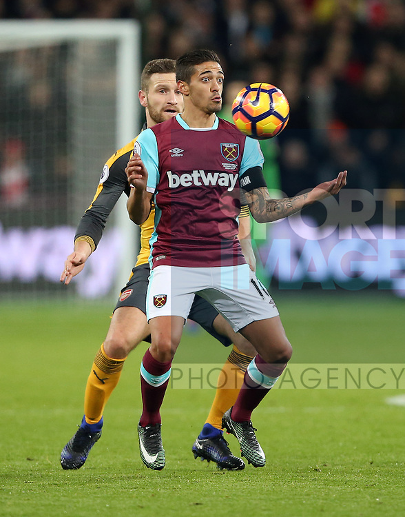 West Ham's Manuel Lanzini tussles with Arsenal's Shkodran Mustafi during the Premier League match at the London Stadium, London. Picture date December 3rd, 2016 Pic David Klein/Sportimage