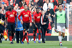 Manchester United's Paul Pogba (third right) hugs Manchester United caretaker manager Ole Gunnar Solskjaer at the end of the Premier League match at Old Trafford, Manchester.