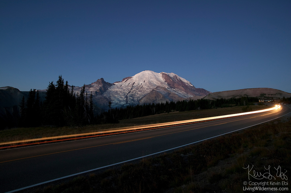 A car travels down the Road to Sunrise in Mount Rainier National Park, Washington. The Road to Sunrise is the highest paved road in Washington state.