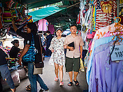 12 JANUARY 2017 - BANGKOK, THAILAND: Shoppers walk through Bo Bae Market. Bo Bae Market is a sprawling wholesale clothing market in Bangkok. There are reportedly more than 1,200 stalls selling clothes made in Thailand and neighboring countries. Bangkok officials have threatened to shut down parts of Bo Bae market, but so far it has escaped the fate of the other street markets that have been shut down.        PHOTO BY JACK KURTZ