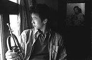CHINA / SHANGHAI JAZZ /..Feng Yu Chen having a break with his  trumpet and L. Armstrong picture in the background..