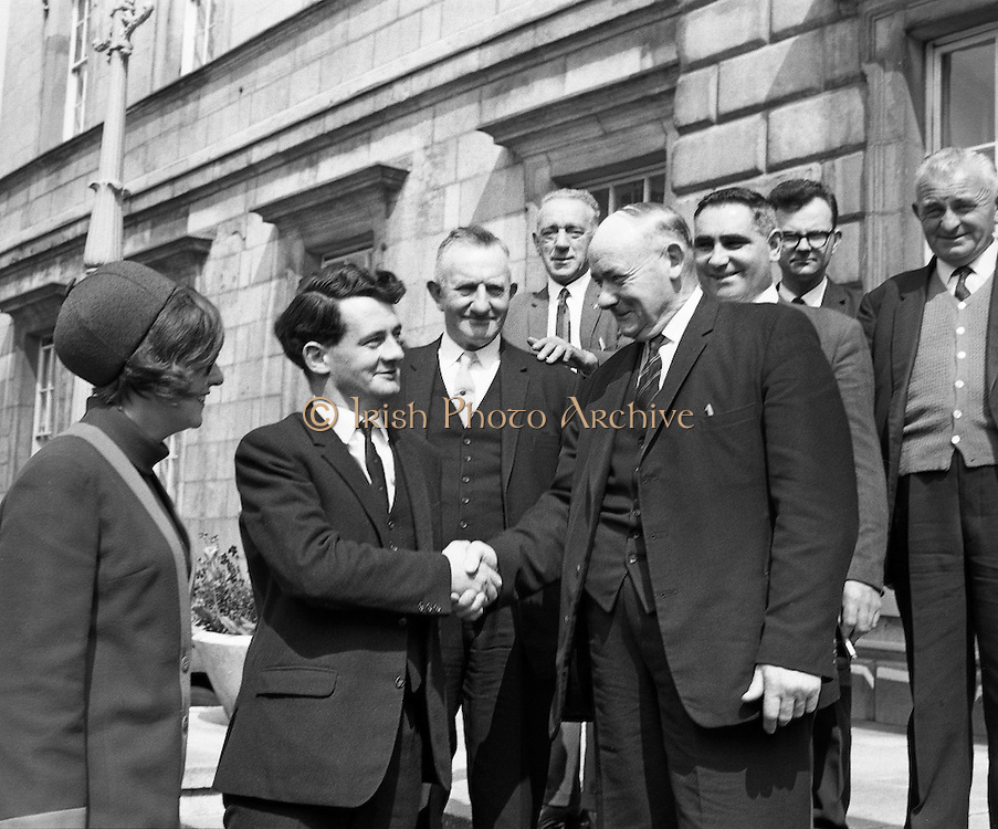 Newly elected Deputy Desmond O'Malley, and his wife, Pat, being welcomed at Dail Eireann by Deputy Paddy Clohessy, Senator Patrick Ryan, and some friends from his East Limerick constituency. .28.05.1968