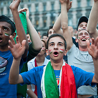 MILAN, ITALY - JUNE 14:  Italian fans cheer at their National team while watching the match Italy vs Paraguay on the maxi screen in Piazza del Duomo on June 14, 2010 in Milan, Italy. Italy's national football team managed a draw 1-1 against Paraguay in their first match of FIFA 2010Soccer World Cup.  Marco Secchi