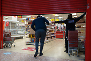 On the day that Elephant & Castle Shopping Centre closes before its demolition and redevelopment, a shopper is refused entry as the shutters come down in Iceland as the mall locks its doors for the final time after 55 years, on 24th September 2020, in south London, England. The much-criticised architecture of the Elephant & Castle Shopping Centre was opened in 1965, built on the bomb damaged site of the former Elephant & Castle Estate, originally constructed in 1898. The centre was home to restaurants, clothing retailers, fast food businesses and clubs where south Londoners socialised and met lifelong partners.