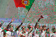 Portuguese team celebrating with supporters at Alameda Dom Afonso Henriques, in Lisbon. Portugal's national squad won the Euro Cup the day before, beating in the final France, the organizing country of the European Football Championship, in a match that ended 1-0 after extra-time.