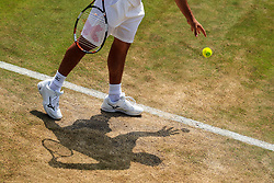 6 July 2017 -  Wimbledon Tennis (Day 4) - Grigor Dimitrov (BUL) casts a shadow as he prepares to serve during his 2nd round match - Photo: Marc Atkins / Offside.