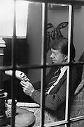 President Jimmy Carter dons his cardigan sweater and makes notes before a speech on the U.S. economy.