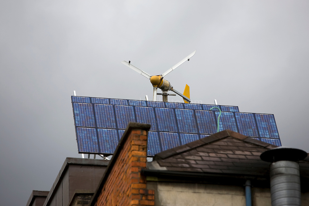 The Green Building, Temple Bar, Dublin, with wind turbines and solar panels on the roof. Build in 1994, uses lots of sustainable energy solutions. This includes using a borehole to pull heat from the ground below. .