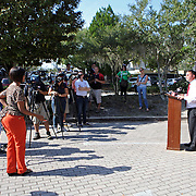 State Representative Darren Soto speaks to the media at the Winter Park Public Library in Winter Park, Florida on Sunday, November 4, 2012. A Florida judge granted extended early voting hours after two suspicious devices closed the Winter Park Library for several hours Saturday. (AP Photo/Alex Menendez)