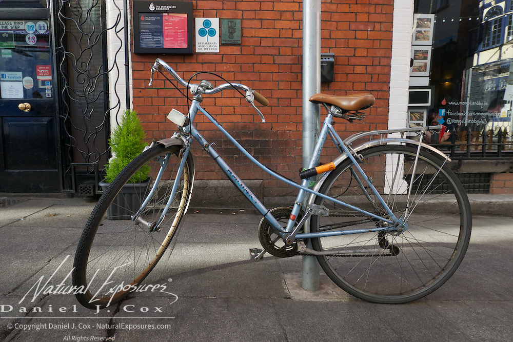A bike parked on the sidewalk in the Temple Bar District of Dublin, Ireland.