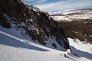 Backcountry skier Judd MacRae drops into a steep couloir below the summit of Hayden Peak, San Juan Mountains, Colorado.