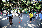 People take their morning exercise of tai chi in Zizhuyuan Park in Beijing, China. This park is well known as a place where middle aged or elderly Chinese come. This can take all forms including some surprising ones. Purple Bamboo Park (Zi Zhu Yuan Gongyuan) also called Zizhuyuan Park or Black Bamboo Park largest parks in Beijing. It is located in the Haidian District. The park consist of three connecting lakes covering over a total area of 48 hectares. Typical of the classical Chinese garden style, and like many of Beijing's parks and gardens, it is a mountain-water landscaped garden. Constructed around canals and large lakes, the Bamboo Park is known for its liberal use of verdant bamboo groves. The garden has a variety of bamboos on display. Young people also believe that if they go to the park as a couple that their relationship is doomed to fail.