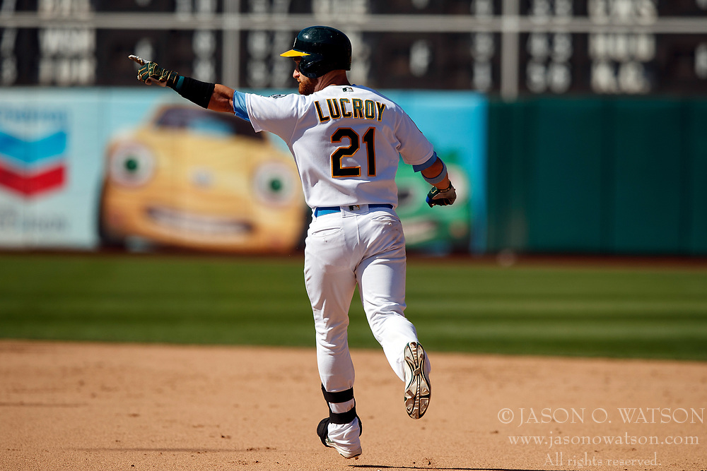 OAKLAND, CA - JUNE 17: Jonathan Lucroy #21 of the Oakland Athletics celebrates after hitting a walk off RBI single against the Los Angeles Angels of Anaheim during the eleventh inning at the Oakland Coliseum on June 17, 2018 in Oakland, California. The Oakland Athletics defeated the Los Angeles Angels of Anaheim 6-5 in 11 innings. (Photo by Jason O. Watson/Getty Images) *** Local Caption *** Jonathan Lucroy