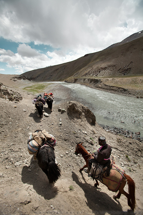 A Kyrgyz caravan approaching the shrines of Bozoi Gumbaz. Between Langar and Bozoi Gumbaz, the entrance to the Little Pamir Plateau...Trekking up and along the Wakhan river, the only way to reach the high altitude Little Pamir plateau, home of the Afghan Kyrgyz community.