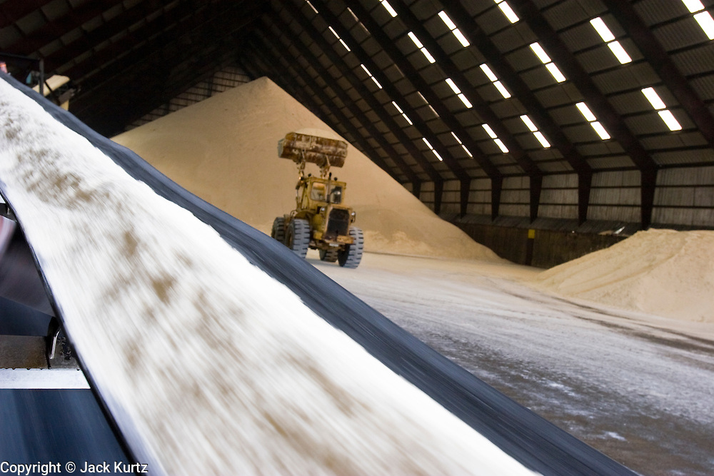 15 NOVEMBER 2005 - FRANKLIN, LA: Raw sugar in the warehouse at the St. Mary Sugar Co-Op Mill near Franklin, Louisiana during the 2005 sugar cane harvest. Sugar mills across Louisiana are being forced to warehouse tens of millions pounds of raw sugar because the sugar refineries in New Orleans are closed because of damage from Hurricane Katrina. The refineries are scheduled to reopen in late 2005. Louisiana is one of the leading sugar cane producing states in the US and the economy in southern Louisiana, especially St. Mary and Iberia Parishes, is built around the cultivation of sugar. The mill employs about 180 people. The two mills near Franklin contribute about $150 million (US) to the local economy. Sugar growers in the area are concerned that trade officials will eliminate sugar price supports during upcoming trade talks for the proposed Free Trade Area of the Americas (FTAA). They say elimination of price supports will devastate sugar growers in the US and the local economies of sugar growing areas. They also say it will ultimately lead to higher sugar prices for US consumers.  PHOTO BY JACK KURTZ