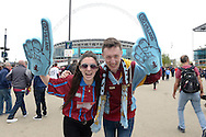 a Pair of Aston Villa  fans cheering outside Wembley Stadium before k/o. The FA Cup, semi final match, Aston Villa v Liverpool at Wembley Stadium in London on Sunday 19th April 2015.<br /> pic by John Patrick Fletcher, Andrew Orchard sports photography.