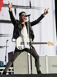 © Licensed to London News Pictures. 28/08/2015. Reading Festival, UK. All Time Low performing at Reading Festival on Day 1 of the festival.   In this picture - Alex GaskarthPhoto credit: Richard Isaac/LNP