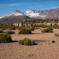 After a cold night in the CONAF Refugio we start a beautiful day driving ahead Volcan Isluga National Park. On the photo you can se old ruins probably formerly used by vicunas shepherds.