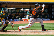 San Francisco Giants catcher Buster Posey (28) hits a double against the Oakland Athletics at Oakland Coliseum in Oakland, California, on March 25, 2018. (Stan Olszewski/Special to S.F. Examiner)