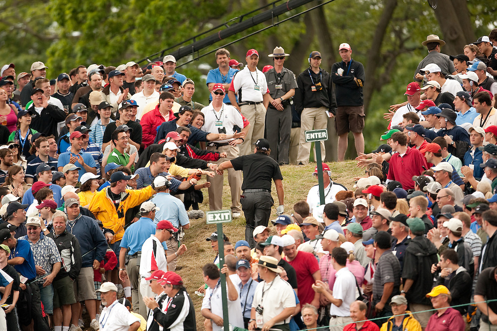 FARMINGDALE, NY - JUNE 19:  Phil Mickelson walks through the gallery during the continuation of the third round of the 109th U.S. Open Championship on the Black Course at Bethpage State Park on Sunday, June 21, 2009. (Photograph by Darren Carroll) *** Local Caption *** Phil Mickelson