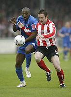 Photo: Aidan Ellis.<br /> Lincoln City v Grimsby Town. Coca Cola League 2, Play off Semi Final. 13/05/2006.<br /> Grimsby's Junior Mendes batles with Lincoln's Ben Futcher