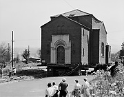 """9119-2368-B18-1.  While moving Ahavai Achim Synagoge, about July 3, 1962, the structure fell apart. The building sat in the middle of the road for awhile, and was then demolished on August 23, 1962. Photo similar to B17-1 published in the July 4, 1962 Oregonian with caption: """"Serious damage to structural supports in Temple Ahavath Achim have delayed moving the 31-year-old structure, according to a report Tuesday from the movers, LeBeck & Son of Portland, The building, at 2400 SW Sherman St., is to be moved to SW Barbur Boulevard and Gibbs Street to make way for Urban Renewal project."""" In the accompanying article it states """"The temple has been moved aout 100 feet west of its original foundations and now sits near the intersection of SW Third Avenue and Sherman Street, both of which are closed.""""<br /> The building was demolished on Thursday, August 23, 1962."""