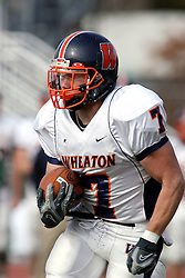 10 November 2007:  Brett Jackson runs the ball for a big gain. This game between the Wheaton College Thunder and the Illinois Wesleyan University Titans was for a share of the CCIW Championship and was played at Wilder Field on the campus of Illinois Wesleyan University in Bloomington Illinois.