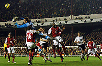 Fotball<br /> Champions League 2004/05<br /> Arsenal v Rosenborg<br /> Highbury - London<br /> 7. desember 2004<br /> Foto: Digitalsport<br /> NORWAY ONLY<br /> Manuel Almunia flaps at the cross which leads to Rosenborg's opening goal