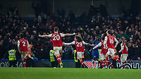 Football - 2019 / 2020 Premier League - Chelsea vs. Arsenal<br /> <br /> Arsenal players chase goalscorer Hector Bellerin (Arsenal FC) after he equalizes in the last minutes at Stamford Bridge <br /> <br /> COLORSPORT/DANIEL BEARHAM