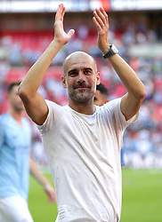Manchester City manager Pep Guardiola celebrates victory after his team win the Community Shield match at Wembley Stadium, London.