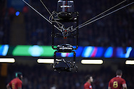 a close up view of the spider cam television camera suspended over the players. Rugby World Cup 2015 quarter-final match, New Zealand v France at the Millennium Stadium in Cardiff, South Wales  on Saturday 17th October 2015.<br /> pic by  Andrew Orchard, Andrew Orchard sports photography.