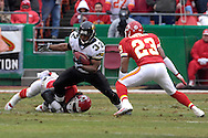 Jacksonville Jaguars running back Maurice Jones-Drew (32) tries to brake away for a Kansas City defender, as Chiefs defensive back Patrick Surtain moves in for the tackle, at Arrowhead Stadium in Kansas City, Missouri, December 31, 2006.  The Chiefs beat the Jaguars 35-30.<br />
