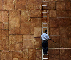 A worker repairs a fountain, in the Trump Tower, while President elect Donald Trump is holding meetings on top floors of the building, November 21, 2016, in New York, NY. (Aude Guerrucci / Pool)