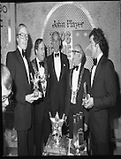 John Player Tops of the Town Final..1980-06-01.1st June 1980.01-06-1980.06-01-80..Photographed at Gaiety Theatre, Dublin....Irish Distillers Variety Group emerge as winner in the John Player Tops of the Town Final. They beat Waterford Banks and Finance by two marks. ..From Left:..Bobby Cooke, Group leader of the Irish Distillers Variety Group holding the Irish National Final Trophy...Alderman Stephen Rogers, Mayor of Waterford...Frank O'Reilly, Chairman of John Player, presenting the National Final Trophy...Alderman William Cummiskey, Lord Mayor of Dublin...Michael Harte, Group leader Waterford Banks and Finance, holding his prize.